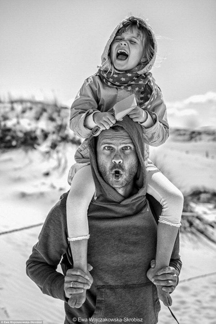 girl-on-the-shoulders-of-her-father